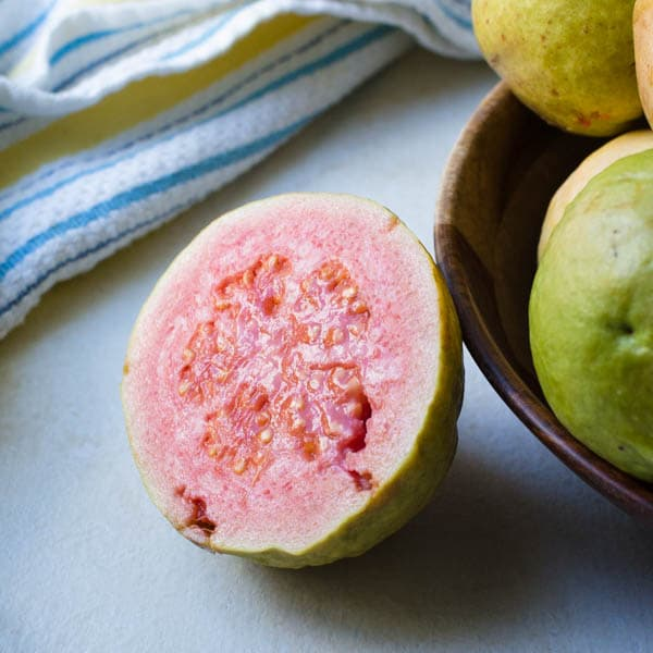 pink guava cut in half.