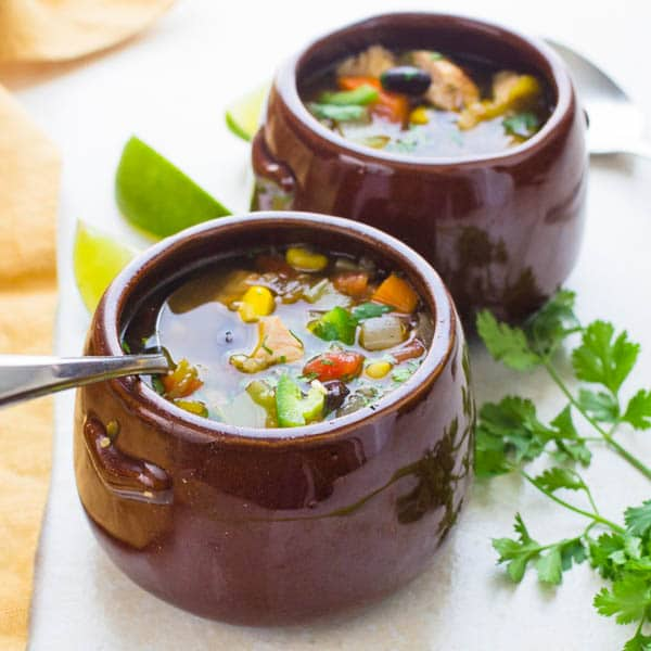 Southwestern Chicken Quinoa Soup in soup crocks.