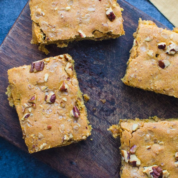 pecan brickle pumpkin blondies on a wooden board.