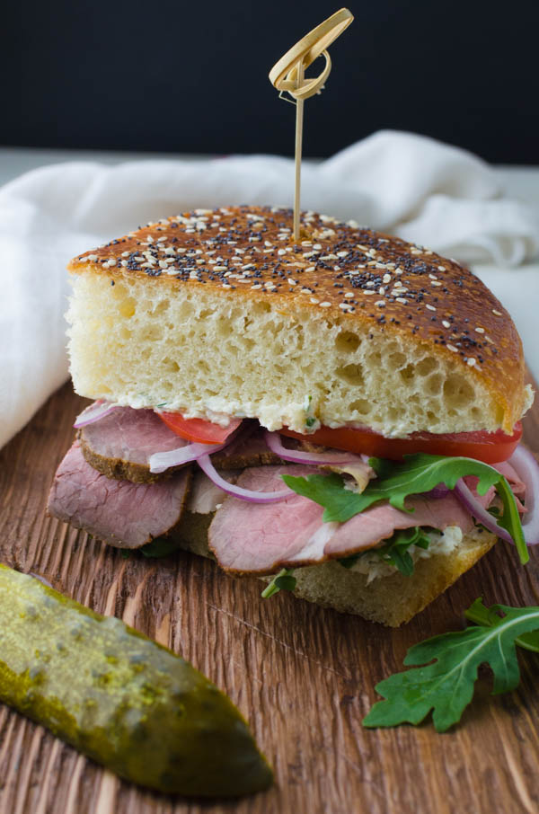 a slice of cold roast beef sandwich with horseradish cheese