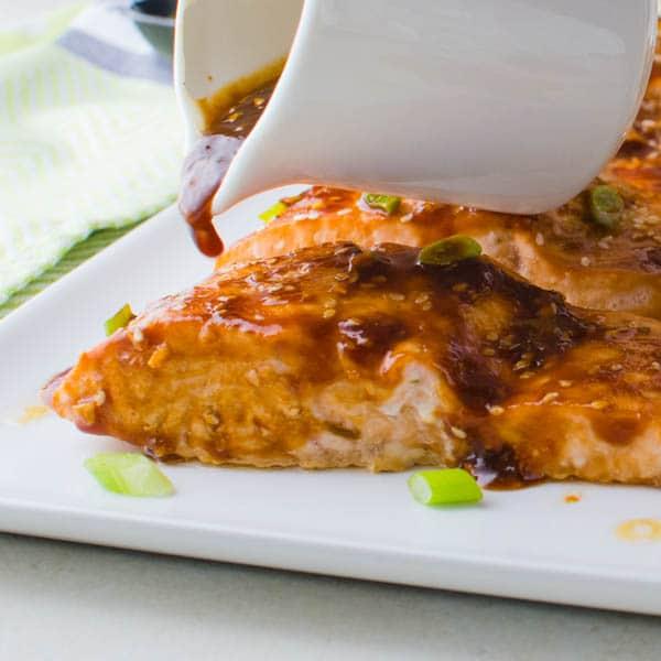 adding extra glaze to the Hoisin-Maple Asian Glazed Salmon.