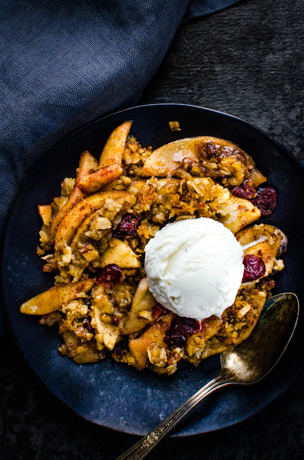 easy baked apple crisp on a plate with ice cream.