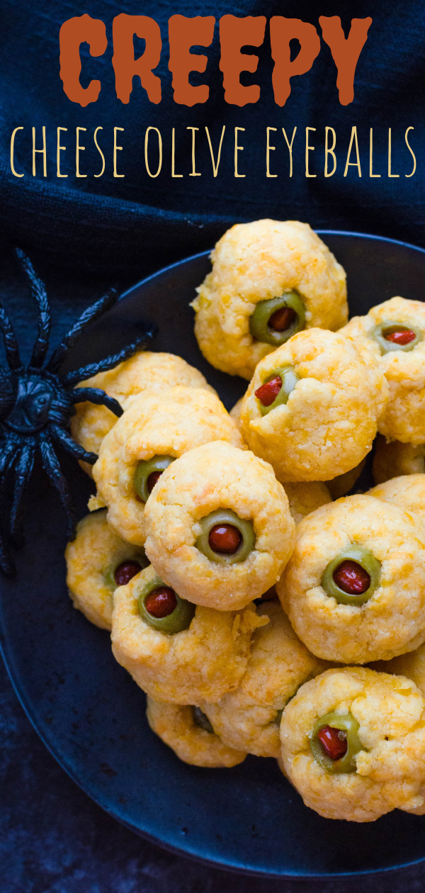 Want a savory Halloween appetizer? These cheese olive balls are easy to make and really delicious. Make a Halloween part appetizer everyone will enjoy! #cheeseballs #cheese #cheddar #appetizer #halloween #halloweensnacks #halloweenappetizer #savoryhalloweenappetizer #halloweenpartyappetizer #halloweenpartyfood #spookyfood #cheeseoliveeyeball #eyeball #cheesepuffs #horsdoeuvres #vegetarian #vegetarianhorsdoeuvres #olives #manzanillaolives