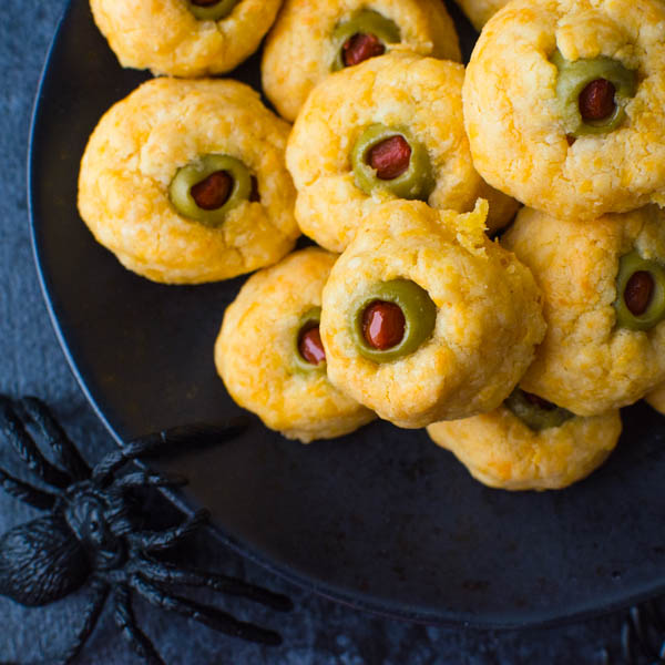 Serving Halloween Party Appetizers on a black plate with spooky spiders.