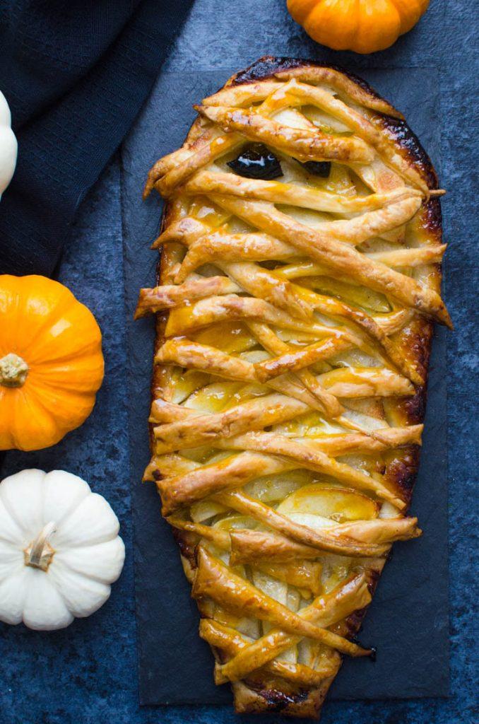 Halloween dessert recipe surrounded by pumpkins.