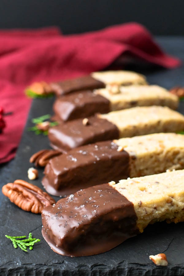 Chocolate Dipped Toasted Pecan Shortbread Cookies on a platter.