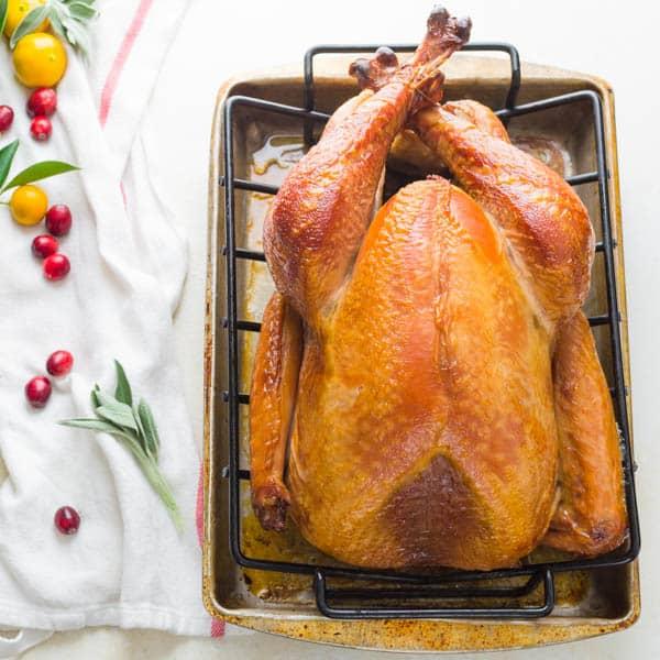 Whole Smoked Turkey on a rack.