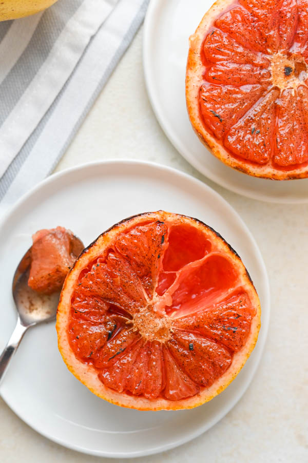 Serving Sugar n' Spice broiled grapefruit on plates with spoons.
