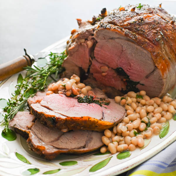 stuffed leg of lamb and white beans.
