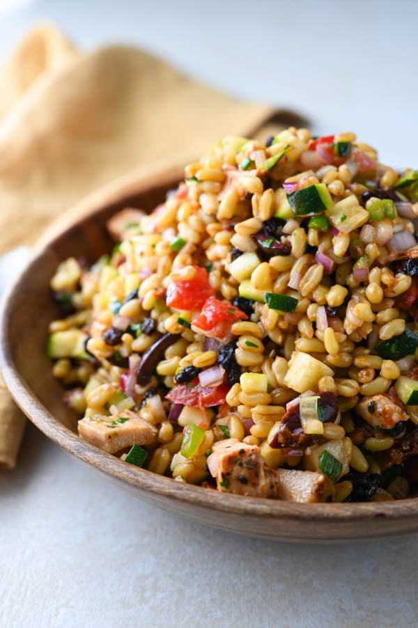 Mediterranean Khorasan Wheat Salad in a wooden bowl.