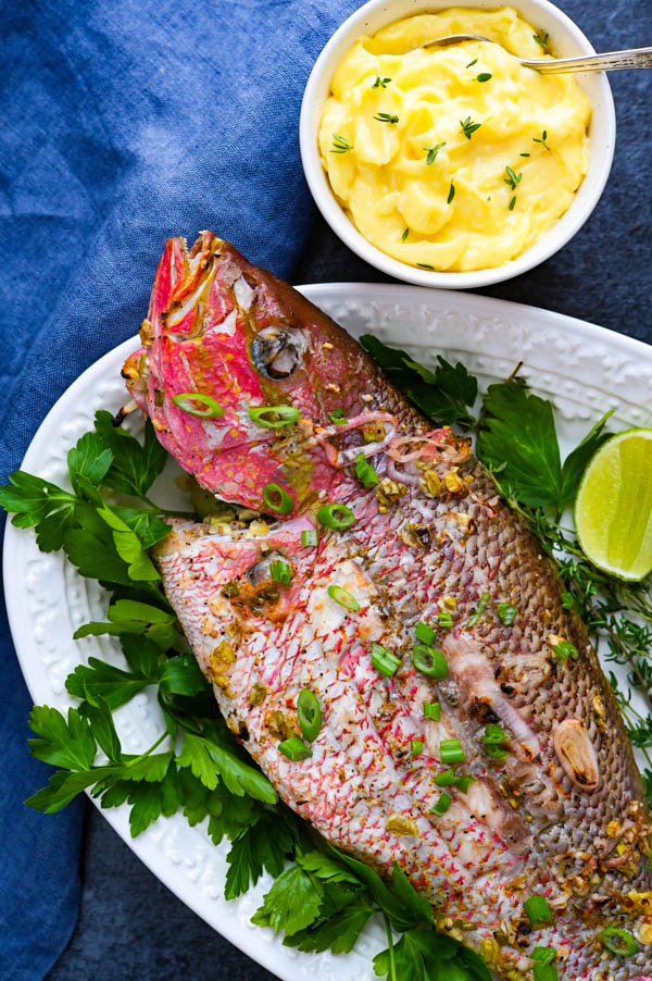 whole grilled snapper on a platter.