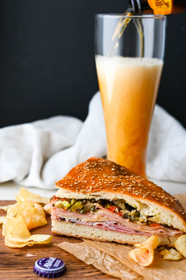 Pouring Abita beer next to the New Orleans sandwich.