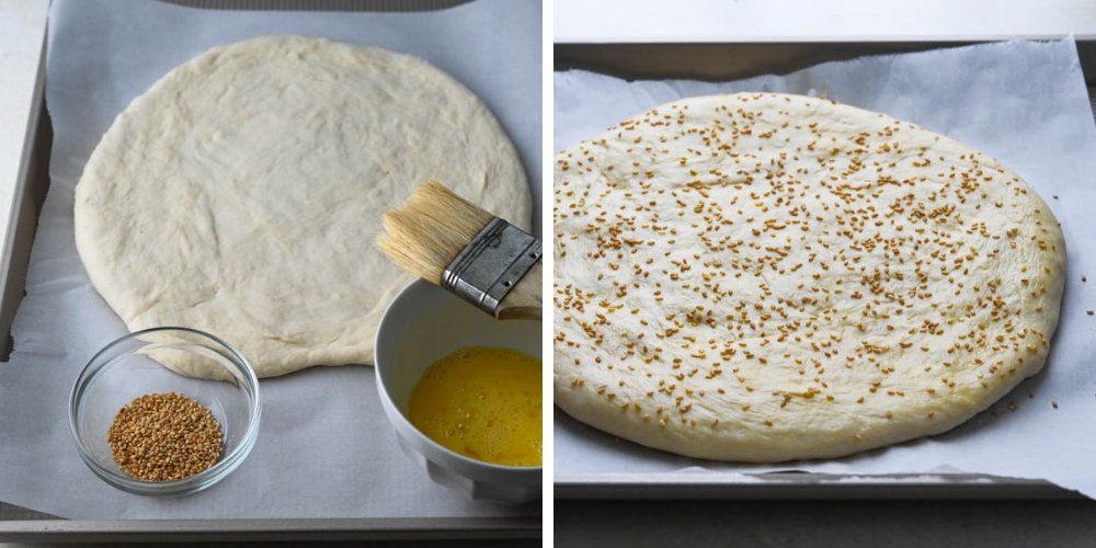 garnishing the round bread with sesame seeds.