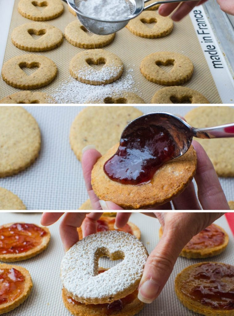 adding powdered sugar to tops, spreading with jam and assembling filled cookies.