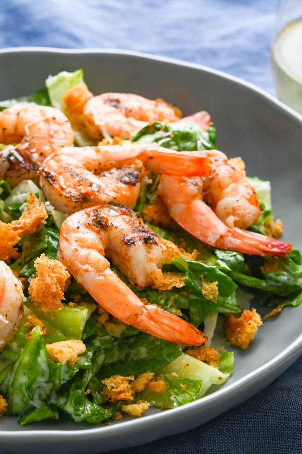A serving of grilled shrimp caesar salad.
