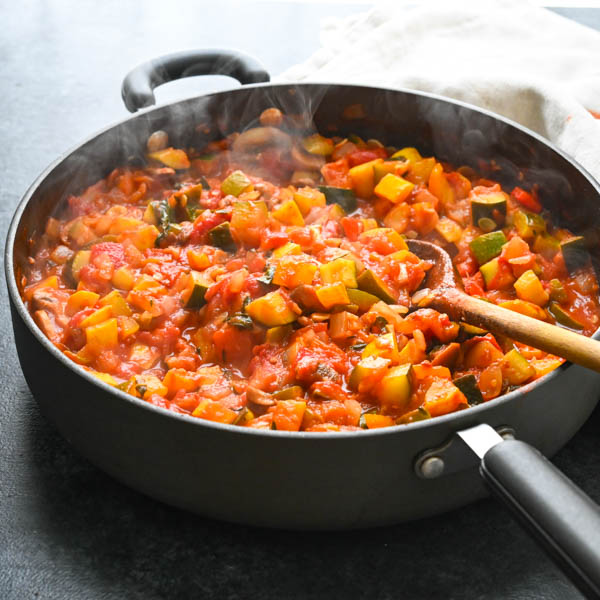 Simmered chunky vegetable ratatouille for lasagna.