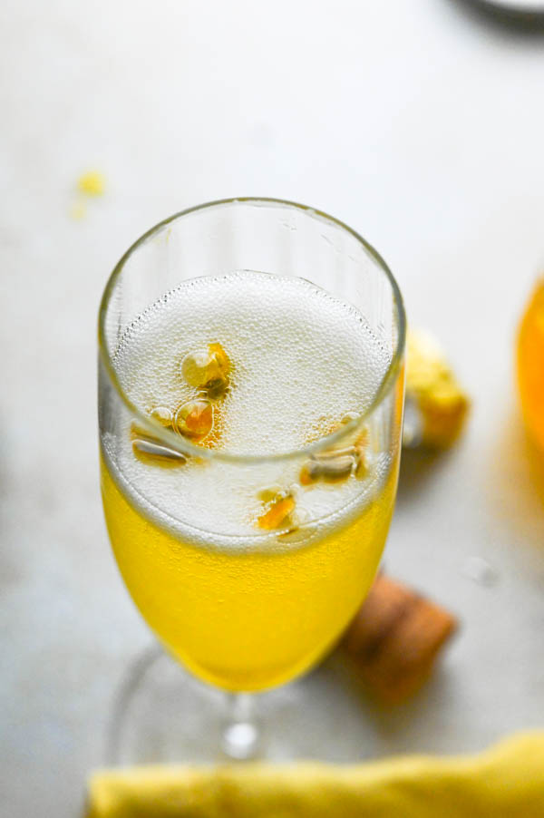 Bubbly Champagne Passion Fruit Cocktail in a flute glass