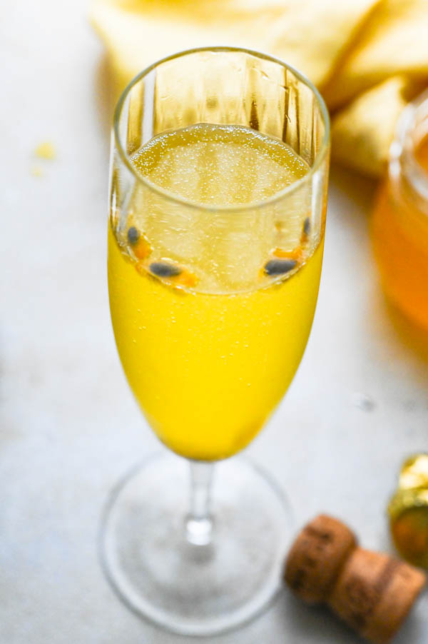 easy bellini recipe with passion fruit seeds floating on top.