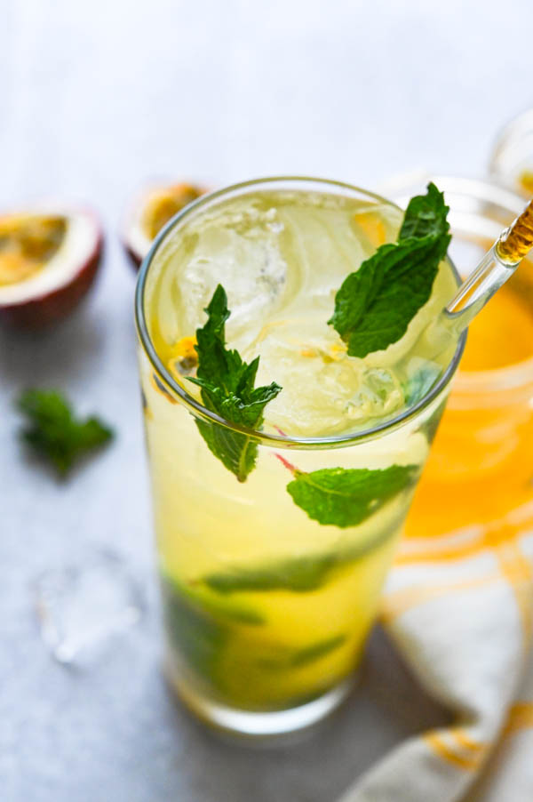 passion fruit mojito with mint leaf garnish.