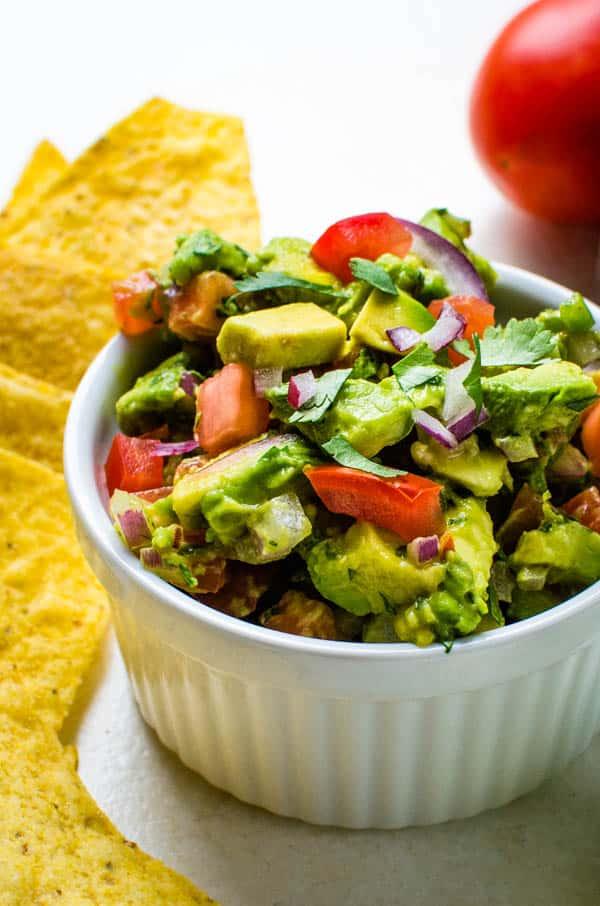 chunky guacamole in a ramekin