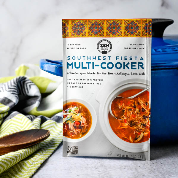 Southwest Fiesta Multi Cooker spice packet standing in front of a dutch oven.