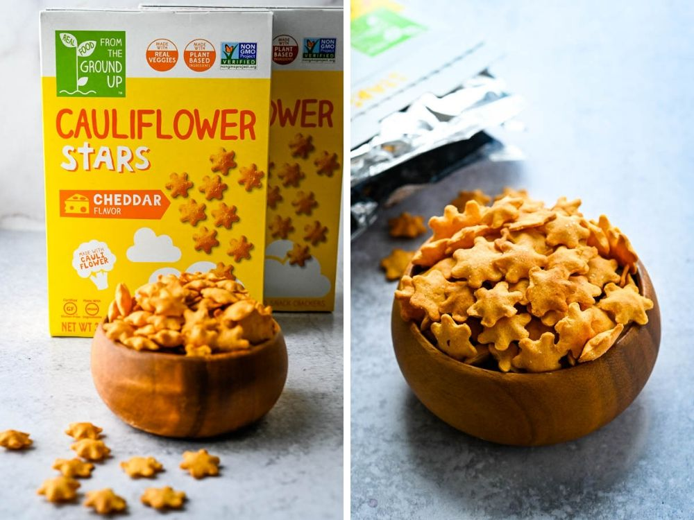Cauliflower Stars in cheddar cheese flavor in a wooden bowl.