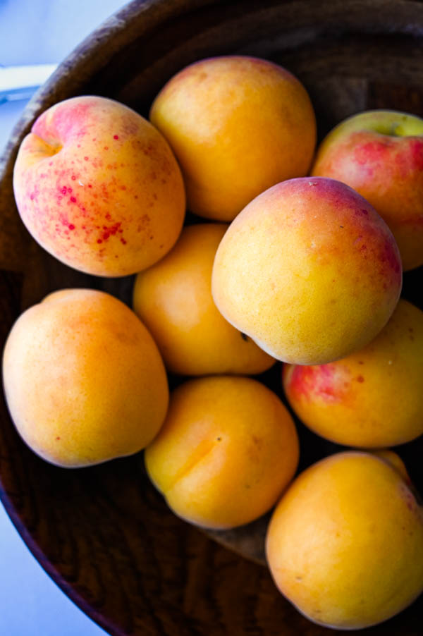 a beautiful bowl of fresh apricots for an apricot dessert with sugared almonds.