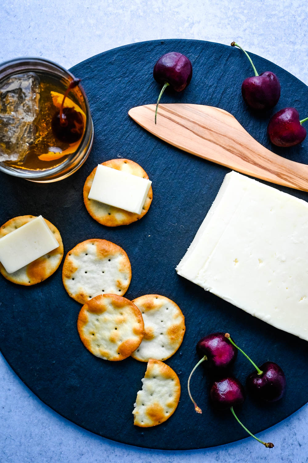 Serving cheese and crackers on a Brooklyn Slate Cheese board.