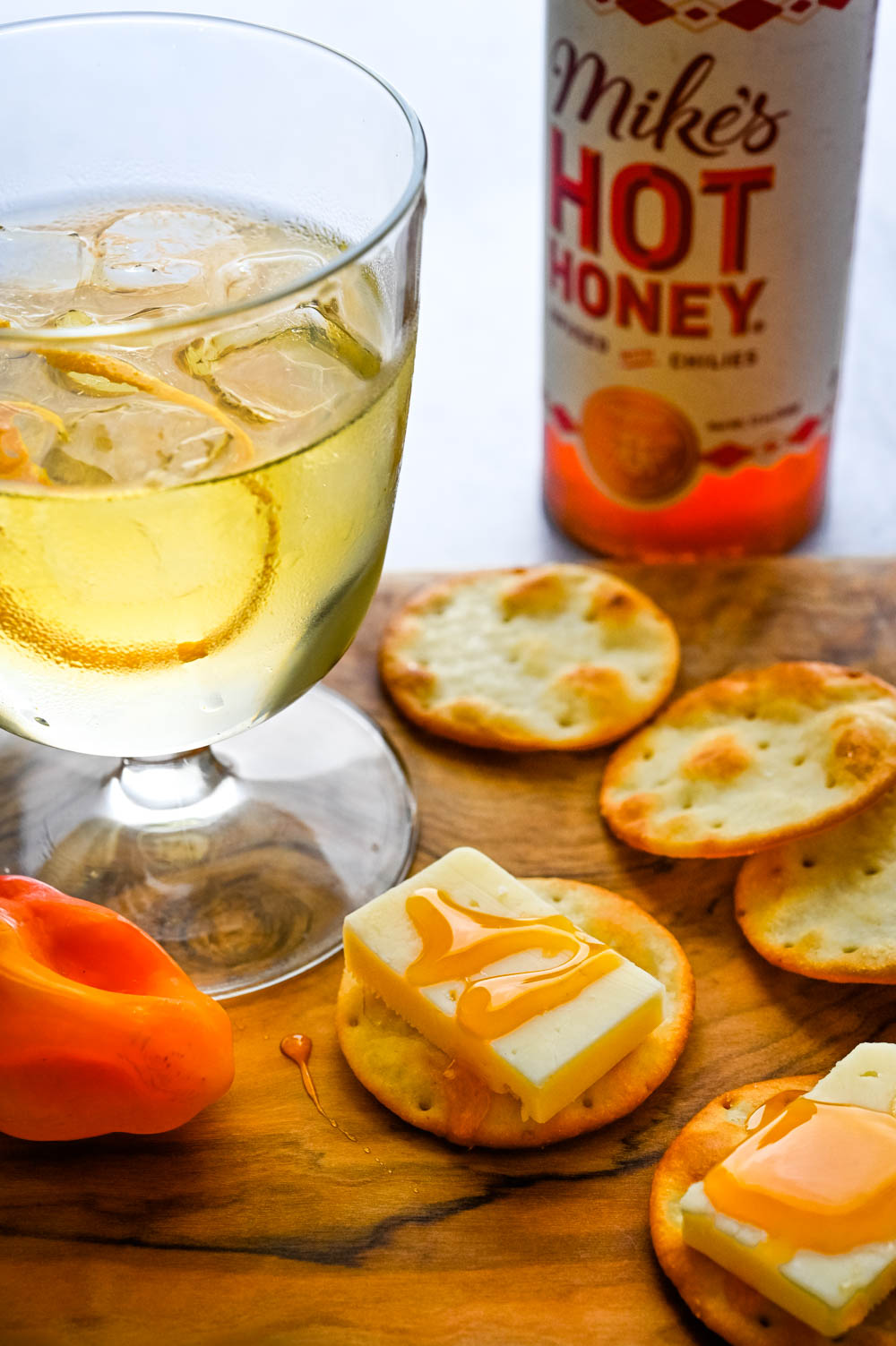 drizzling hot honey over cheese and crackers from the summer fancy food show.