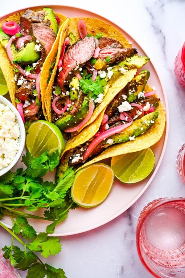 serving tacos on a platter.