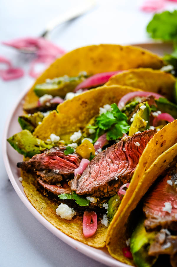 close up view of the beef and grilled avocados in the tacos