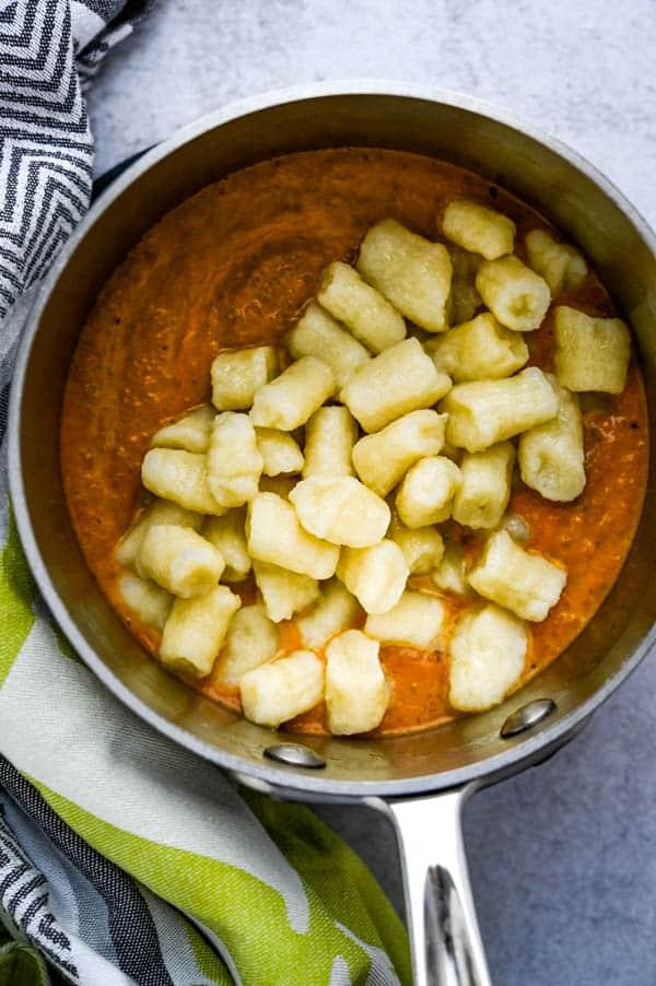 add the potato pasta to the gnocchi cream sauce.