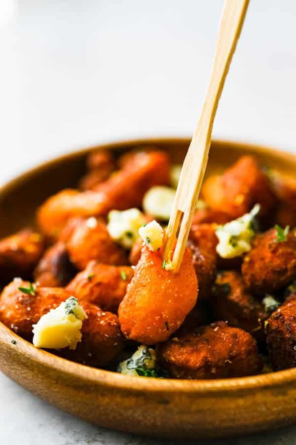 gnocchi appetizer on a cocktail fork.