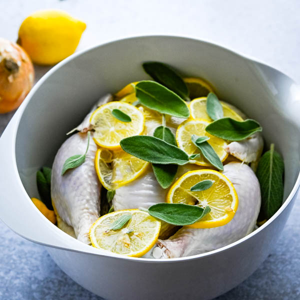 coating the chicken in lemons and sage for roast chicken marinade.