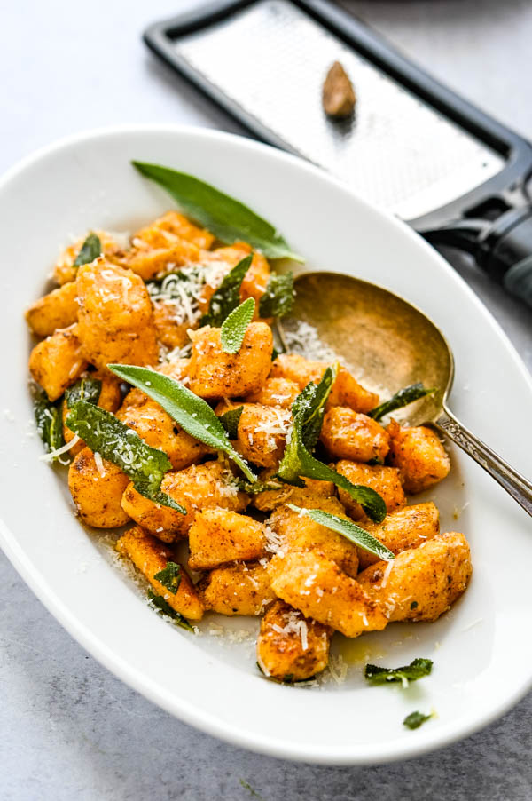 Finishing the brown butter gnocchi with crispy fried sage leaves.