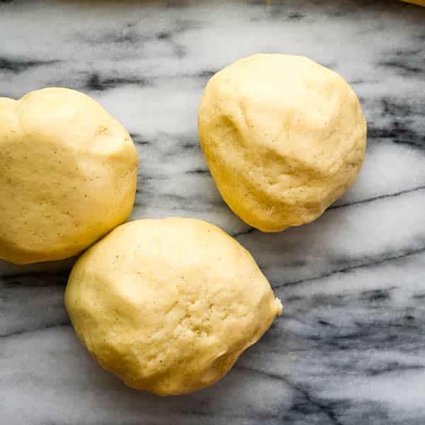 separate the almond crescents dough into balls.