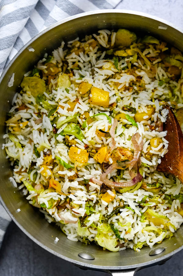 adding roasted fall vegetables for healthy rice side dishes.