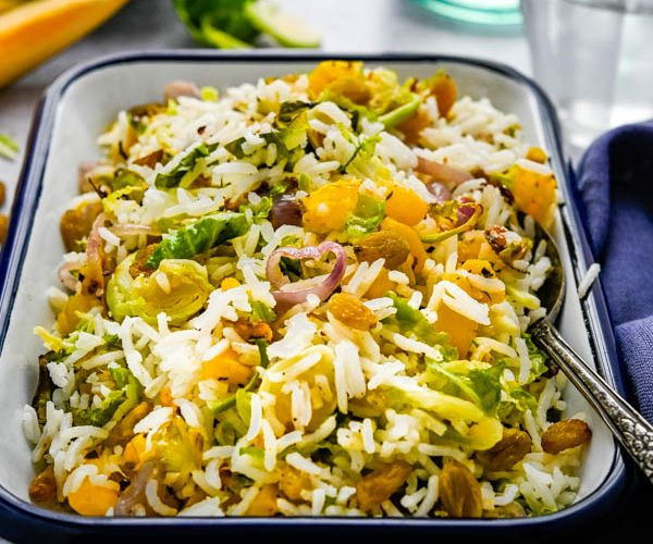steamed basmati rice and roasted shaved brussels sprouts with acorn squash.