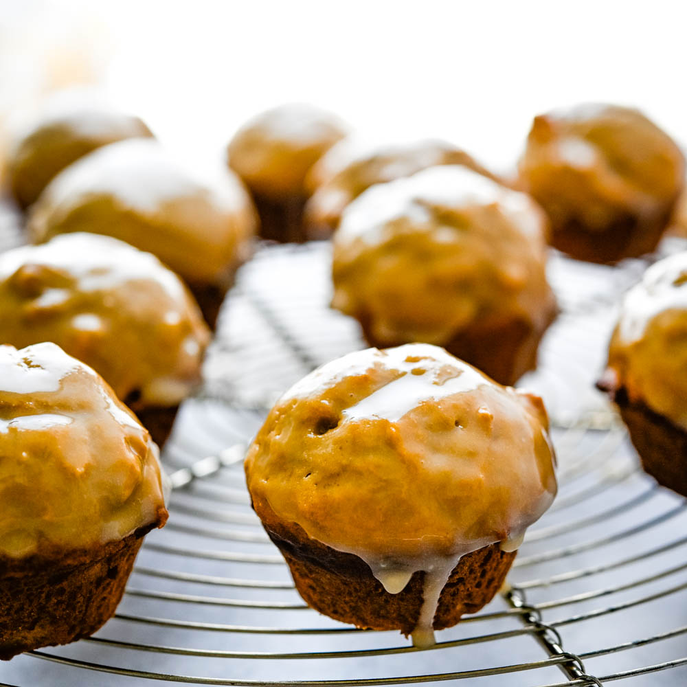 maple glazed mini muffins on a wire rack.