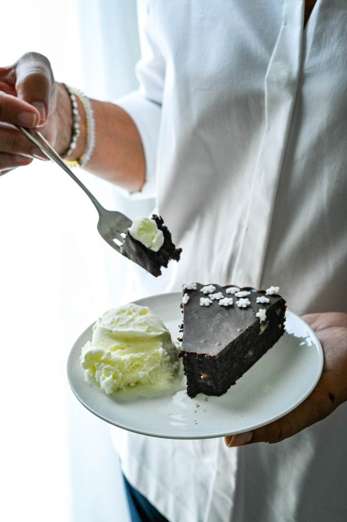 Family enjoying a this dark chocolate fudge fancy dessert recipes with vanilla ice cream.