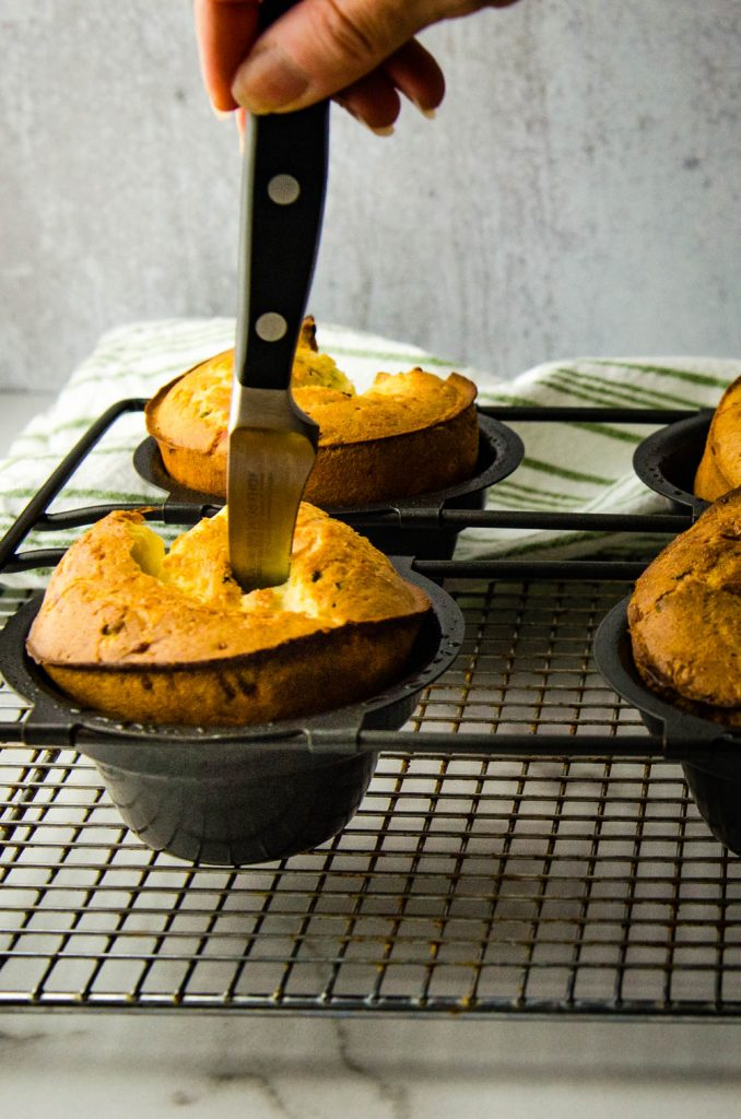 While the buns are still in the popover pan, pierce the top to allow the steam to escape.