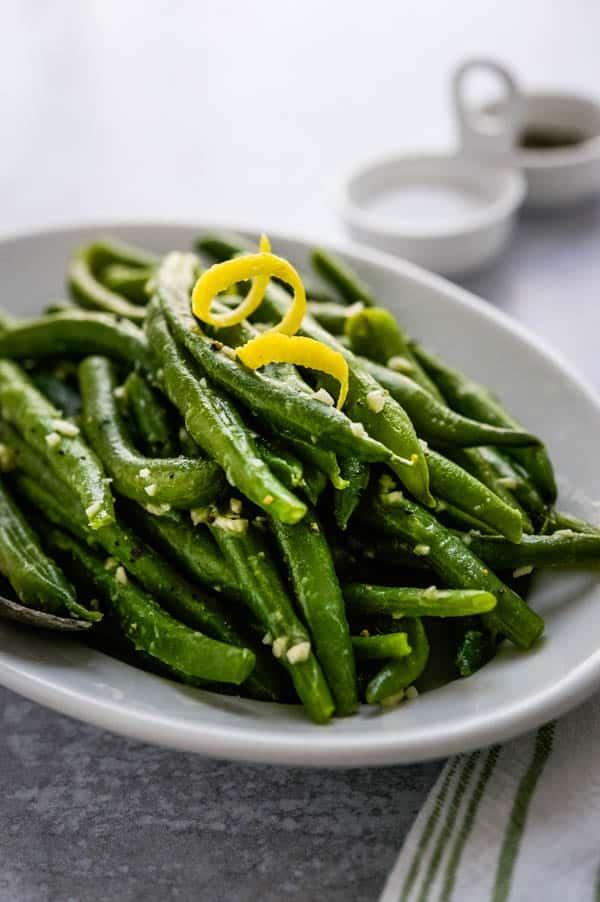 Lemon Garlic green Beans with a swirl of lemon zest.