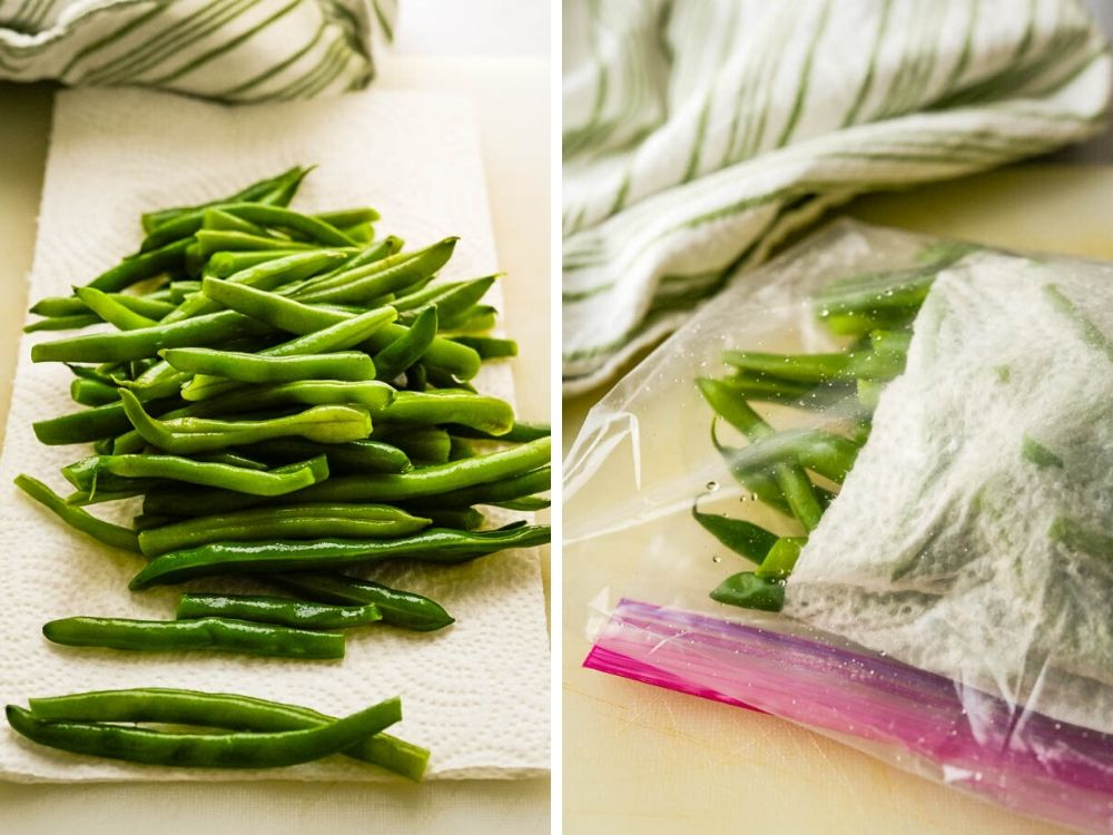 After blanching green beans, drying them on a towel and wrapping them for later.