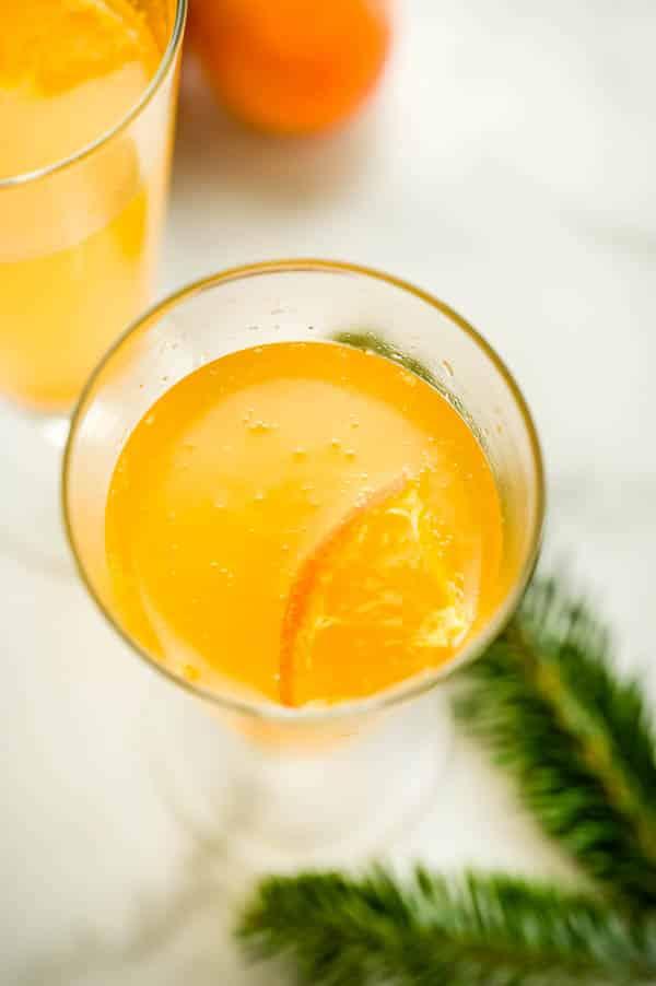 tangerine slice floating in the drink.