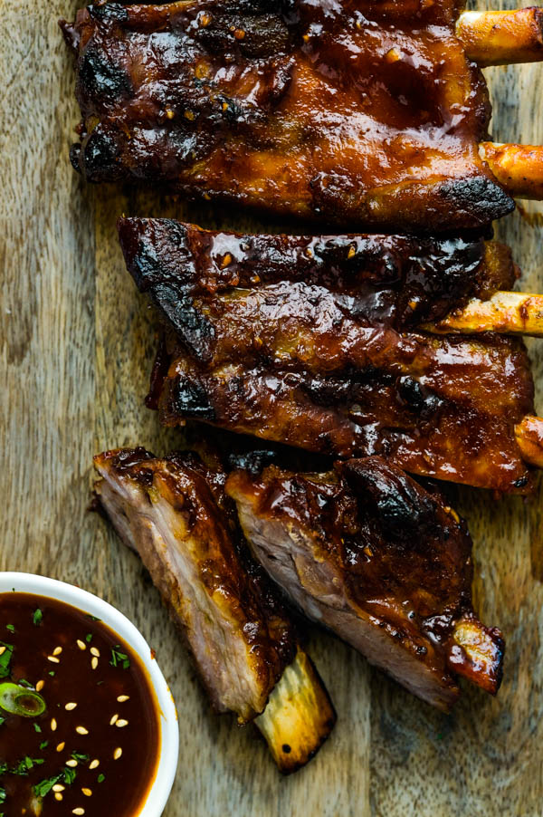 Serving Korean ribs on a platter with dipping sauce.