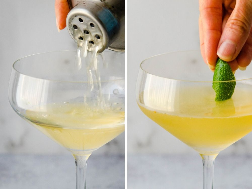 straining the white cosmopolitan into a coupe glass and garnishing with a lime.