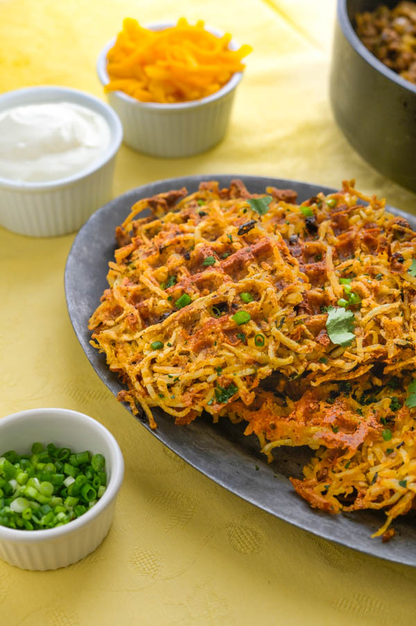 crispy hash browns on a platter. Perfect for family dinners.
