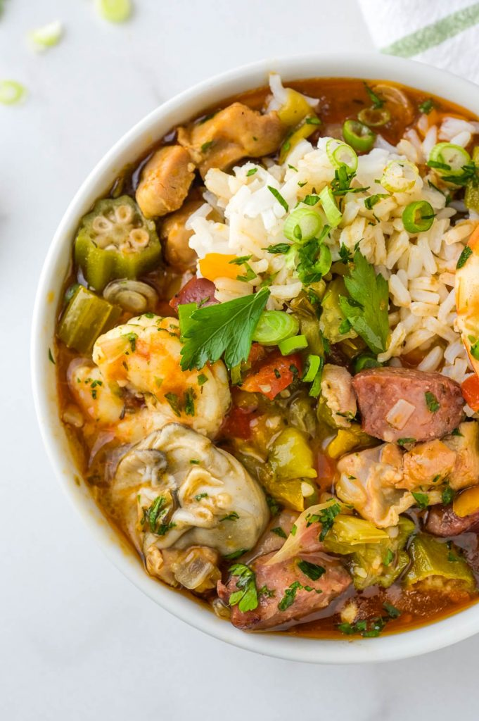 Seafood Chicken and Sausage Gumbo with Rice and hot sauce.