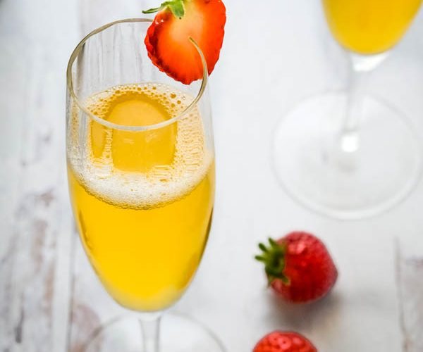 Sparkling Elderflower Prosecco Cocktail in a glass with strawberries.