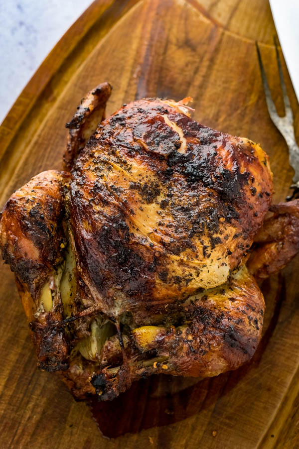 the cooked bird on a cutting board.